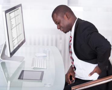 bad-posture-office-desk-man-holding-back
