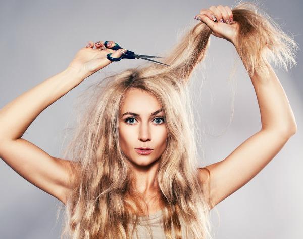 Woman cut her hair. Problem of split ends