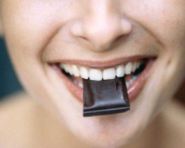 woman-eating-dark-chocolate-large